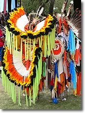 Pow Wow dancers with Fancy Dance bustles